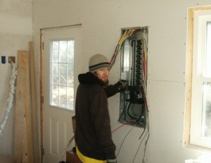 Josh trimming out main electrical panel