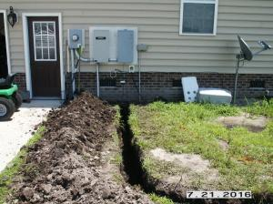 Trench from service for outbuilding electrical power