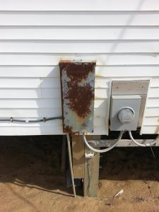 22| electrical main disconnect and meter base on ocean cottage 03, same - three years later