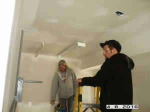 Jeannie-Josh-hanging-fluorescent-lights-in-garage-trim-out
