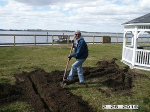 Jeannie trenching for  electrical run for power to a gazebo